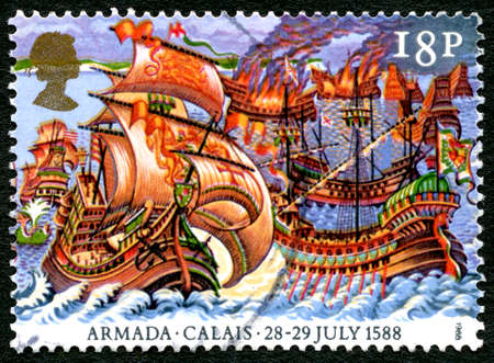 attacked: GREAT BRITAIN - CIRCA 1988: A used postage stamp from the UK, commemorating the 28th-19th July 1588 when the Spanish Armada was attacked in Calais, circa 1988.