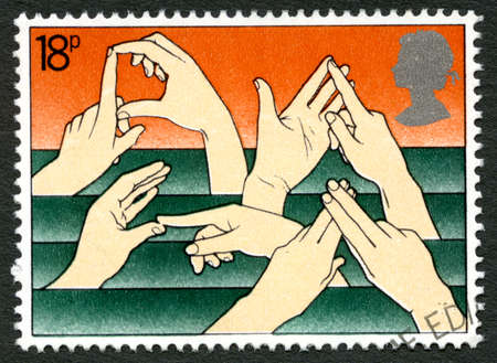 gestures: GREAT BRITAIN - CIRCA 1981: A used postage stamp from the UK, depicting various hand gestures used in sign language, circa 1981.