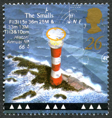 GREAT BRITAIN - CIRCA 1998: A used postage stamp from the UK, depicting an illustration of historic Smalls Lighthouse in Wales, circa 1998.