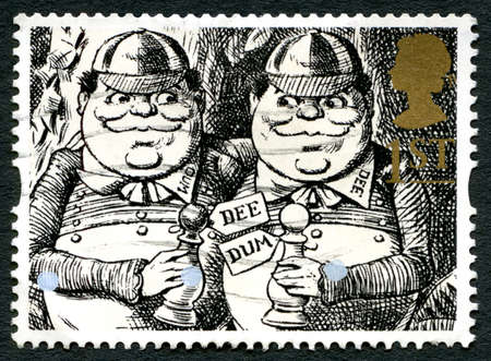 lewis carroll: GREAT BRITAIN - CIRCA 1993: A used postage stamp from the UK, depicting an image of Tweedle Dum and Teedle Dee from Alice Through the Looking Glass, circa 1993.