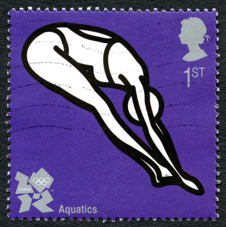 olympic games: GREAT BRITAIN - CIRCA 2012: A used postage stamp from the UK, celebrating Aquatics at the London 2012 Olympic Games, circa 2012.