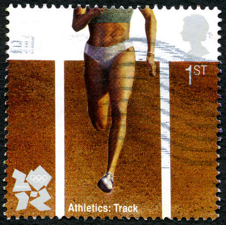 olympic games: GREAT BRITAIN - CIRCA 2012: A used postage stamp from the UK, celebrating Athletics at the London 2012 Olympic Games, circa 2012.