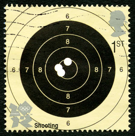 olympic games: GREAT BRITAIN - CIRCA 2012: A used postage stamp from the UK, celebrating the Shooting event at the London 2012 Olympic Games, circa 2012.