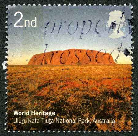 GREAT BRITAIN - CIRCA 2005: A used postage stamp from the UK, depicting an image of historic landmark Uluru in Australia, circa 2005.
