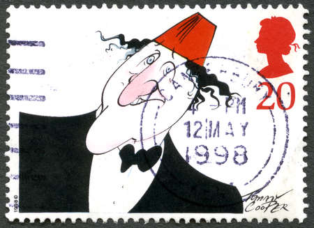 celeb: GREAT BRITAIN - CIRCA 1998: A used postage stamp from the UK, commemorating british comedy legend Tommy Cooper, circa 1998. Editorial