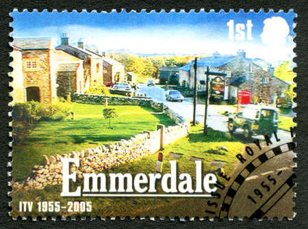 programmes: GREAT BRITAIN - CIRCA 2005: A used postage stamp from the UK, depicting a scene from ITV soap drama Emmerdale - celebrating the 50th Anniversary of the ITV channel, circa 2005.