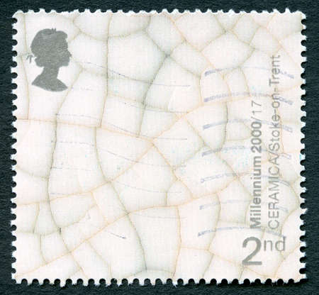 ceramica: GREAT BRITAIN - CIRCA 2000: A used postage stamp from the UK, celebrating Ceramica - a museum in Burslem, Stoke-on-Trent which explored the history of the pottery industry in the area, circa 2000.