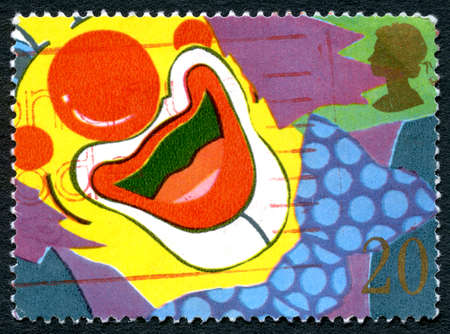 GREAT BRITAIN - CIRCA 1990: A used postage stamp from the UK, celebrating smiles and happiness by depicting an illustration of a Clowns smile, circa 1990. Editorial