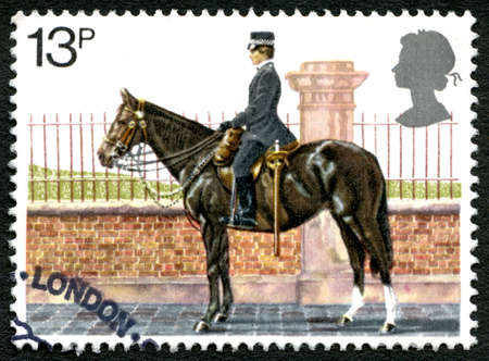 GREAT BRITAIN - CIRCA 1979: A used postage stamp from the UK, depicting an illustration of a policewoman  from the Metropolitan Police Force mounted on horseback, circa 1979.