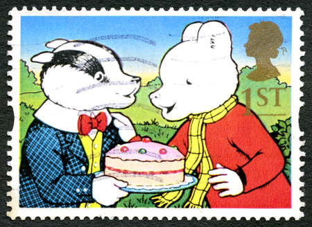 GREAT BRITAIN - CIRCA 1993: A used postage stamp from the UK, depicting an illustration of famous comic strip characters Rupert the Bear and Bill Badger, circa 1993. Editorial