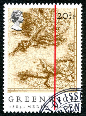 lexicographer: GREAT BRITAIN - CIRCA 1984: A used postage stamp from the UK, commemorating the Greenwich Meridian, circa 1984. Editorial