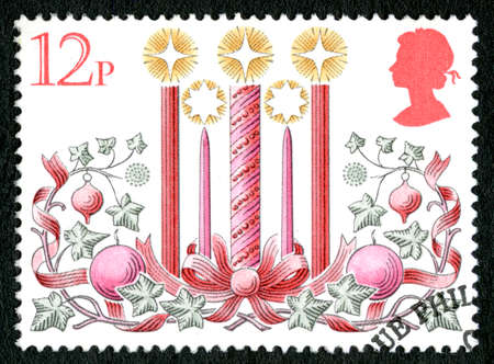 GREAT BRITAIN - CIRCA 1980: A used postage stamp from the UK, depicting a festive Christmassy illustration of lit Candles with Xmas decorations, circa 1980.
