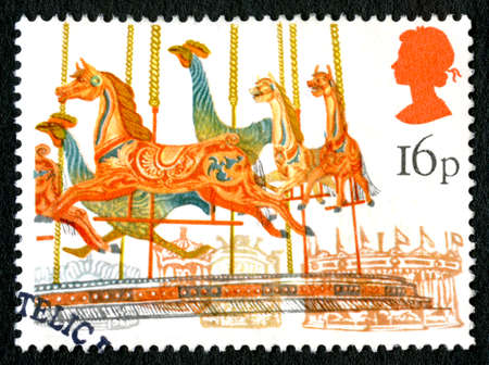 GREAT BRITAIN - CIRCA 1983: A used postage stamp from the UK, depicting an illustration of a Carousel at a Fun Fair, circa 1983.