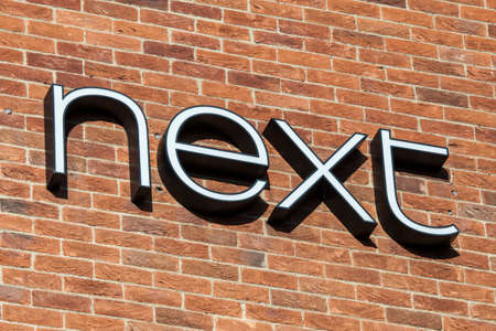 homeware: NORWICH, UK - JANUARY 17TH 2017: The Next logo on the exterior of their store in Norwich city centre, on 17th January 2017. Editorial
