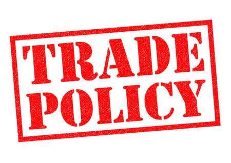 trades: TRADE POLICY red Rubber Stamp over a white background.