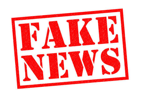 newsfeed: FAKE NEWS red Rubber Stamp over a white background.