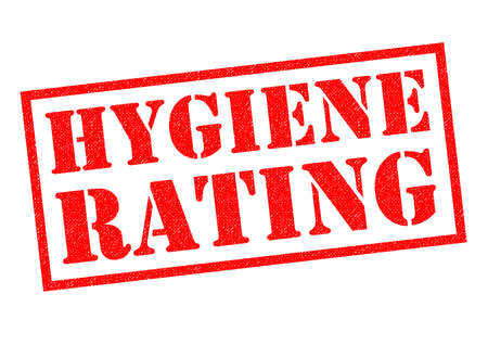 filth: HYGIENE RATING red Rubber Stamp over a white background. Stock Photo