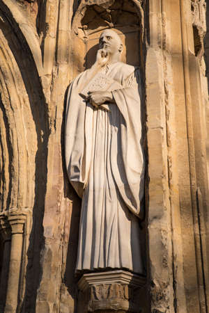 benedict: A sculpture of St. Benedict on the exterior of the West Porch of Norwich Cathedral in the historic city of Norwich, UK.