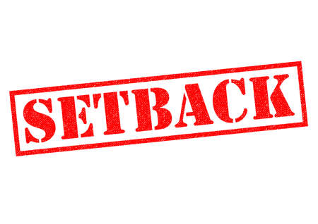 hindering: SETBACK red Rubber Stamp over a white background.