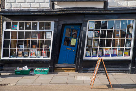 CANTERBURY, UK - FEBRUARY 13TH 2017: A slanted door to a bookshop in the historic city of Canterbury in the UK, on 13th February 2017.