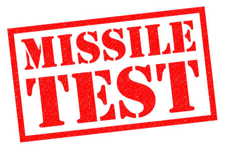 warned: MISSILE TEST red Rubber Stamp over a white background.