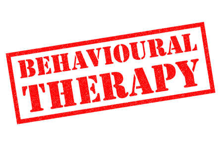 BEHAVIOURAL THERAPY (UK spelling) red Rubber Stamp over a white background.