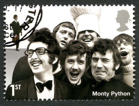 UNITED KINGDOM - CIRCA 2015: A used postage stamp from the UK, depicting a portrait of legendary British comedy troupe Monty Python, circa 2015.