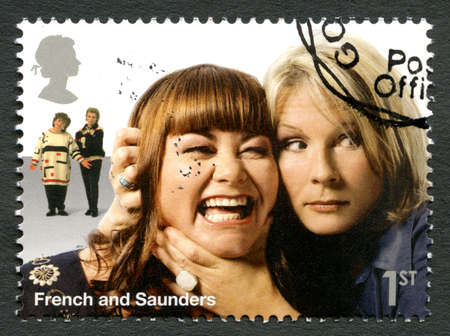 duo: UNITED KINGDOM - CIRCA 2015: A used postage stamp from the UK, depicting a portrait of legendary British comedy double-act French and Saunders, circa 2015. Editorial