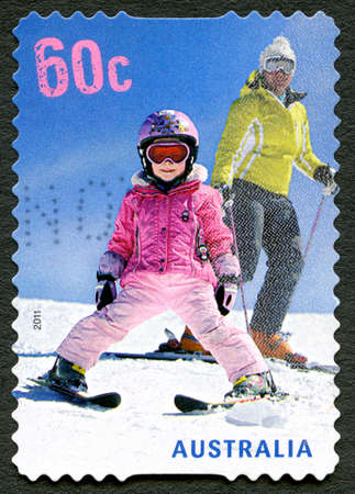 AUSTRALIA - CIRCA 2011: A used postage stamp from Australia, depicting an image of a child skiing with a parent, circa 2011. Editorial