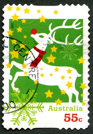 AUSTRALIA - CIRCA 2012: A used postage stamp from Australia, depicting an illustration of Rudolph the red-nosed Reindeer, celebrating Christmas, circa 2012.