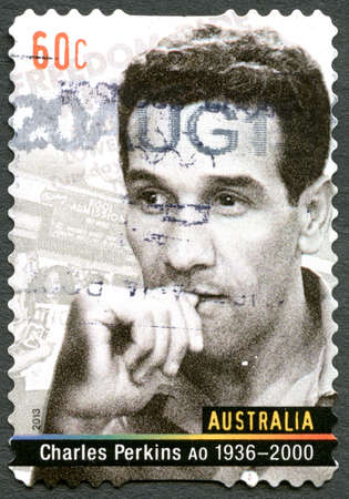 AUSTRALIA - CIRCA 2013: A used postage stamp from Australia, depicting a portrait of Charles Perkins, an Australian Aboriginal activist and soccer player, circa 2013.