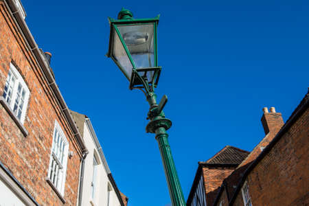 The famous leaning lamp post situated on the historic Steep Hill in the city of Lincoln, UK.