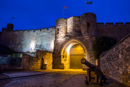 A dusk-time view of the East Gate of Lincoln Cathedral in the historic city of Lincoln, UK. Stock Photo
