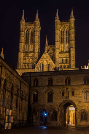 A view of the magnificent Lincoln Cathedral with Exchequer Gate and the Magna Carta public house in the foreground, in Lincoln, UK. Stock Photo