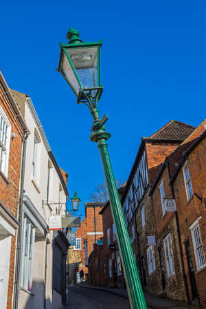 LINCOLN, UK - FEBRUARY 28TH 2017: The famous leaning lamp post situated on the historic Steep Hill in the city of Lincoln, UK on 28th February 2017.