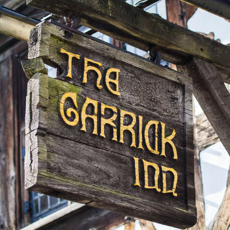 half timbered house: STRATFORD-UPON-AVON, UK - MARCH 2ND 2017: The sign above the main entrance to the Garrick Inn Public House in Stratford-Upon-Avon, on 2nd March 2017.  It is reputedly the oldest pub in the town.