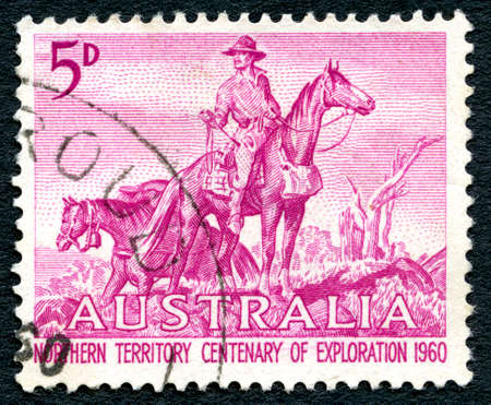 drover: AUSTRALIA - CIRCA 1960: A used postage stamp from Australia, depicting an illustration of an Overlander and celebrating 100 years of Northern Territory Exploration, circa 1960.