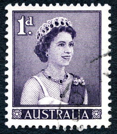 philately: AUSTRALIA - CIRCA 1959: A used postage stamp from Australia, depicting a portrait of Queen Elizabeth II, circa 1959.