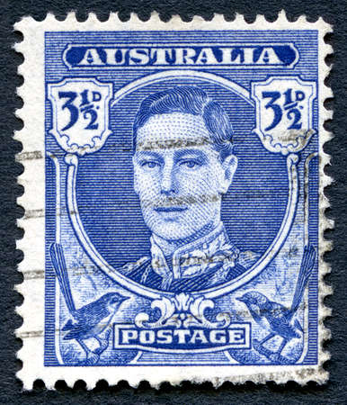 philately: AUSTRALIA - CIRCA 1942: A used postage stamp from Australia, depicting a portrait of King George VI, circa 1942.