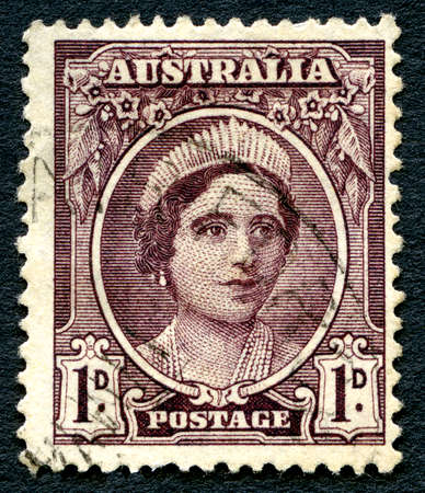 philately: AUSTRALIA - CIRCA 1942: A used postage stamp from Australia, depicting a portrait of Elizabeth Bowes Lyon, later affectionately known as the Queen Mother, circa 1942. Editorial