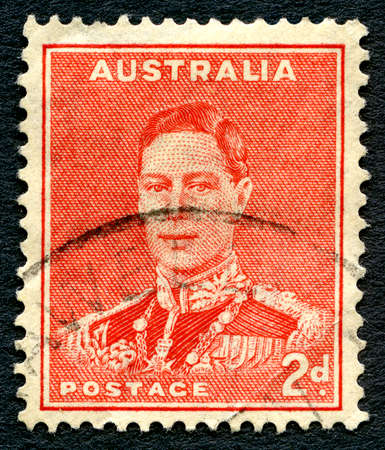 philately: AUSTRALIA - CIRCA 1937: A used postage stamp from Australia, depicting a portrait of King George VI, circa 1937.