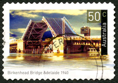 adelaide: AUSTRALIA - CIRCA 2004: A used postage stamp from Australia, depicting an image of Birkenhead Bridge in Adelaide, Australia, circa 2004.