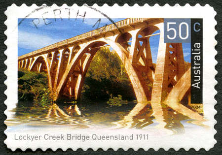 AUSTRALIA - CIRCA 2004: A used postage stamp from Australia, depicting an image of Lockyer creek Bridge in Queensland, Australia, circa 2004.