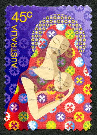 AUSTRALIA - CIRCA 2004: A used postage stamp from Australia, depicting an illustration of a mother and child, symbolising Mary and Baby Jesus, circa 2004.