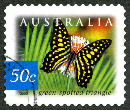 AUSTRALIA - CIRCA 2003: A used postage stamp from Australia, depicting an illustration of a Green Spotted Triangle Butterfly, circa 2003.
