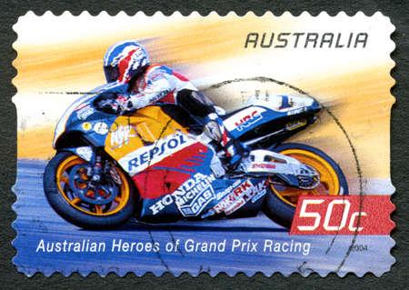 repsol honda: AUSTRALIA - CIRCA 2004: A used postage stamp from Australia celebrating Australian Heroes of Grand Prix Racing, with an image of Mick Doohan, circa 2004.