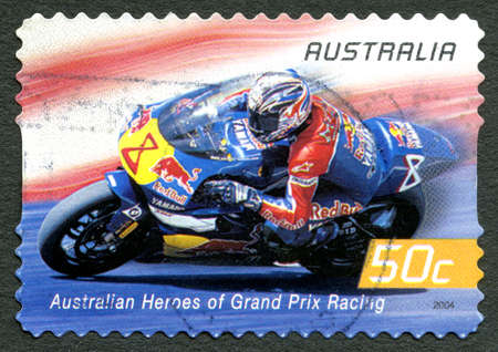 AUSTRALIA - CIRCA 2004: A used postage stamp from Australia celebrating Australian Heroes of Grand Prix Racing, with an image of Garry McCoy, circa 2004.