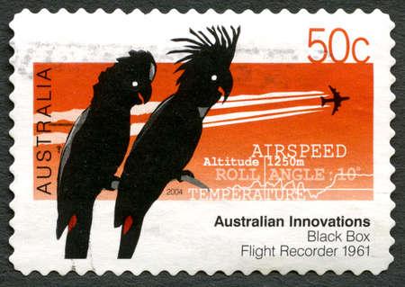 AUSTRALIA - CIRCA 2004: A used postage stamp from Australia, celebrating Australian Innovations - this one commemorating the Black Box Flight Recorder, circa 2004.