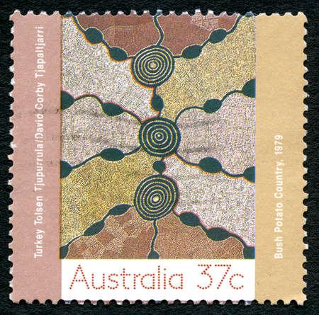 AUSTRALIA - CIRCA 1979: A used postage stamp from Australia, depicting aborginal artwork entitled Bush Potato Country, circa 1979.