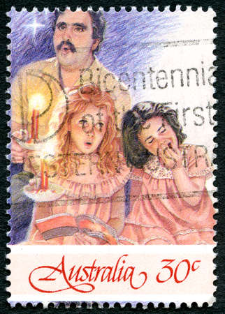 AUSTRALIA - CIRCA 1987: A used postage stamp from Australia, depicting a festive Christmas illustration of Carol Singers, circa 1987.